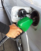 Closeup of man pumping gasoline fuel in car at gas station.  — Stock Photo