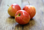 Red apple fruit on wood background — Stock Photo