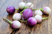 Fresh eggplant on wooden background — Stock Photo