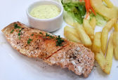 Grilled Salmon with Fresh Salad Leaf and french fries — Photo