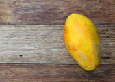 Papaya on wooden background  — Stock Photo
