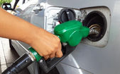Woman hand refilling the car with fuel  — Stock Photo