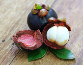 Fresh mangosteen fruit on wood  — Stock Photo