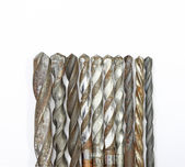 Set of drill bits isolated in white  — Stock Photo