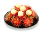 Rambutan on plate — Stock Photo