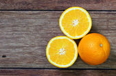 Fresh oranges on wooden background  — Stockfoto