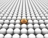 Golden ball with a dollar symbol on it in a crowd of white balls — Stock Photo