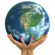 Stock Photo: Hands holding big realistic globe ball