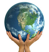Hands holding big realistic globe ball — Stock Photo