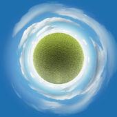 Miniature planet with plain grass — Stock Photo