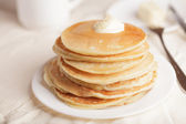 Pancakes with sour cream — Stock Photo