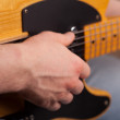 Royalty-Free Stock Photo: Brown guitar in hands in the guy playing 