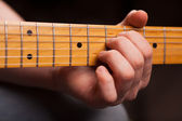 Brown guitar in hands in the guy playing іт — Stock Photo