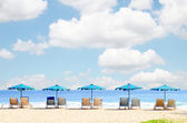 Beach chairs and with umbrella on the beach in cloudy day — Stock Photo