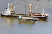 Vessel bulk cargo beside cargo boat — Stock Photo