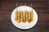Roasted meatballs in white dish on wooden table — Stock Photo