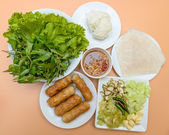 Vietnamese food pork sausage with vegetable (nam nuang) — Stock Photo