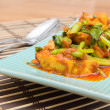 Fried Tofu with chinese kale in red curry saurce — Stock Photo