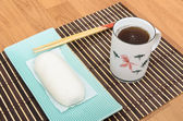 Mantou Chinese steamed bun in green dish on bamboo mat — Stock Photo