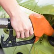 Women hold Fuel nozzle to add fuel in car at gas station — Stock Photo