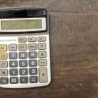 The Old calculator on wooden table — Stock Photo #38215793