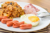 American fried rice with pork sausage, bacon and fried egg — Foto Stock