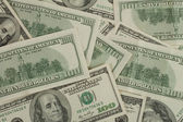 Background with randomly scattered dollars — Stock Photo