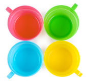 Four plastic cups with handles — Stock Photo