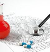 Tube, stethoscope and pills — Stock Photo