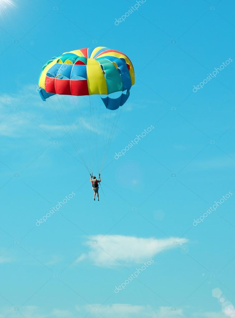 Bold paratrooper flying in bright parachute in the sky — Stock Photo #12764736