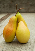 Three ripe pears with cuttings — Stock Photo