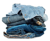 A large stack of colored denim products — Stock Photo