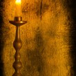 A burning candle in a candlestick — Foto de Stock