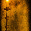 A burning candle in a candlestick — Photo