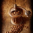 Stock Photo: Antique coffee grinder with shiny seeds