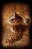 Antique coffee grinder with shiny seeds — Stock Photo