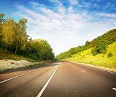 Asphalt road stretches — Stock Photo