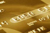 Fragment of golden credit card — Stock Photo