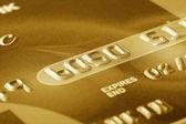 Fragment de carte de crédit or — Photo
