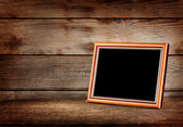 Empty wooden picture frame — Stock Photo
