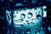 Background of ice cube with drops — Foto Stock