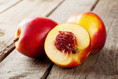 Three ripe juicy nectarine — Stock Photo