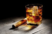Glass of whiskey with a cigar — Stock Photo