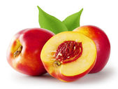 Ripe juicy nectarine with leaves — Stock Photo