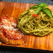 Spaghetti with Basil Pesto & Eggplant Parmesan — Stock Photo