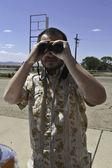 Man with Binoculars Facing Camera — Stock Photo