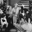 Woman singing with children on staircase at Christmas — Stock Photo #12288686