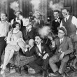 Group of sitting in a living room smoking — Stock Photo #12299191