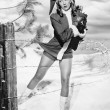 Woman in a Santa costume getting caught on a barbed wire fence — Stock Photo #12300170