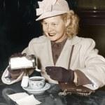 Woman adding sugar to beverage — Stock Photo #12302616